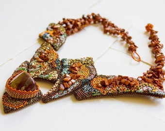 beaded necklace in in orange colour with Jasper stone