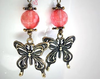 Earrings with butterflies in bronze and pink ball