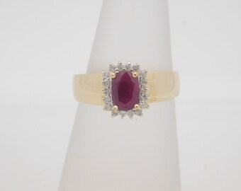 1.25 Carat T.G.W. Ladies Oval Ruby & Round Diamonds 10K Yellow Ring