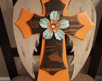 Orange Wooden Stacked Cross with Wings and Flower Accent