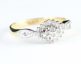 Diamond cluster engagement ring in 9 carat gold for her