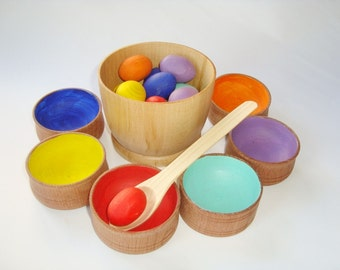 Sorting eggs. Wood rainbow eggs. Wooden eggs. Wooden toys