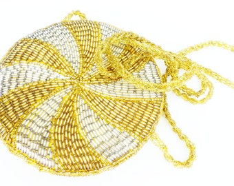 Vintage heavy beaded purse in champagne gold and white silver bugle beads. Sweet little evening bag.