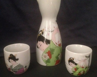 Japanese White Porcelain Geisha Sake Serving Set Decanter and 2 Cups~Label