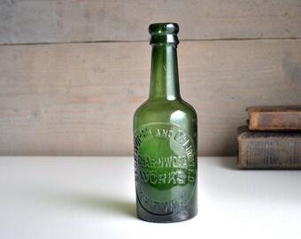 Vintage green glass bottle. Rustic old mineral water bottle. Vintage dig bottle. Beckworth, Charnwood, Whitwick.