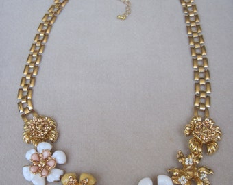 Lovely Strand of Soft Yellow, White and Pink Open Petaled Flower Necklace