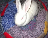 giant plump Ugli Donut bunny bed chunky knit wool