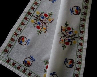 Vintage German hand cross-stitched white centerpiece -- Bunny-bums, Easter eggs, baskets and trees -- from Germany