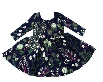 Twirling Dress with Long Sleeves and Scoop Neck in Jade, Magenta and White on Navy 'Thistle' Print