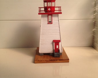 wooden model lighthouse of Caissie Point NB.