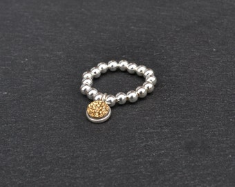 Sterling Silver Stretch Ring with Sparkly Gold Charm