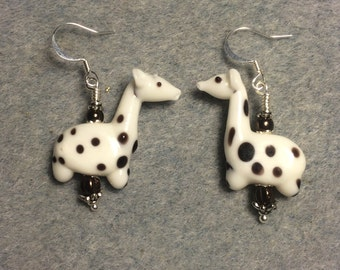 White with brown spots lampwork giraffe bead earrings adorned with brown Czech glass beads.