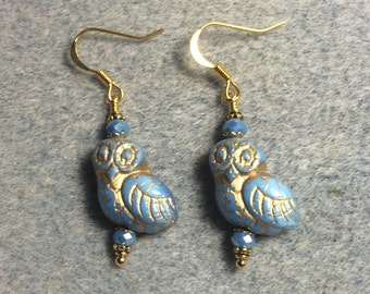 Light blue with gold wash fancy Czech glass owl bead earrings adorned with light blue Chinese crystal beads.