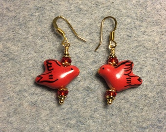 Red ceramic dove bead earrings adorned with red Chinese crystal beads.