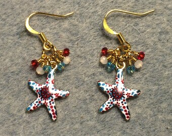 Dark red and turquoise enamel starfish charm earrings adorned with dark red, white, and turquoise Chinese crystal beads.