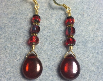 Wine red Czech glass pear drop earrings adorned with wine red Czech glass beads.