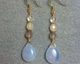 Milky Czech glass pear drop earrings adorned with clear Czech glass beads.