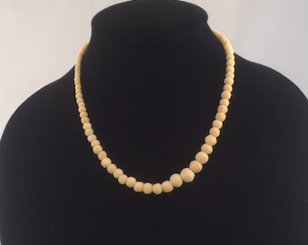 Vintage Cream Colored carved stone necklace