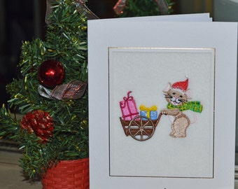 A new machine embroidered hand finished Christmas card -- Mouse With Cart Full Of Presents.