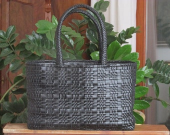 Blue woven leather bag