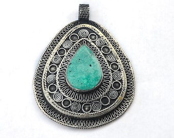 7 Hand Crafted Silver and Turquoise Afghan Pendant.