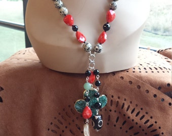 One long strand necklace with three dangling drops