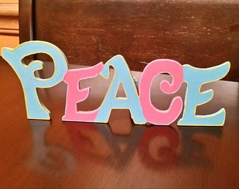 """Hand painted wooden """"Peace"""" sign"""