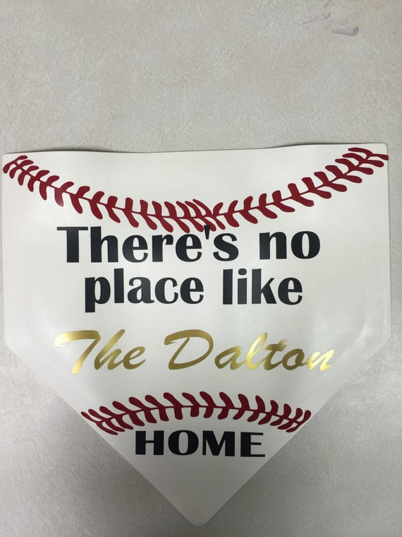 Theres no place like home home plate sign.