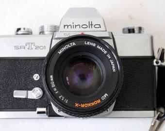 Minolta Camera SLR SRT 201 With Camera Caddy Strap
