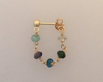A single 18k gold & multi-gem ear chain