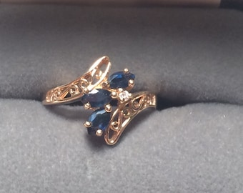 Beautiful T&C 14k yellow gold ring with sapphire and diamond