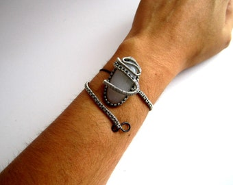 ethnic style bracelet to wrap , natural white stone and black and silver metal son .