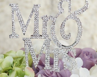 Large Bold Font Silver Mr and Mrs wedding cake topper covered in crystal rhinestones wedding decoration