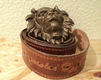 Vintage embossed leather belt with a lion's head buckle