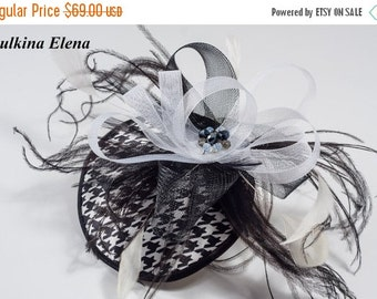 Black and white fascinator with feather