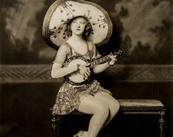 Alfred Cheney Johnston Photo, Ziegfeld Girl with banjo and sombrero, 1920
