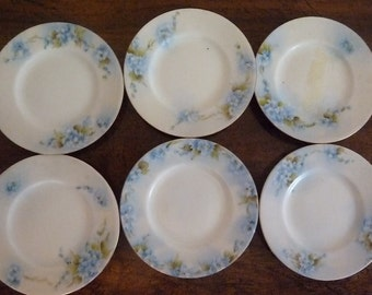 Six small butter plate by limoge