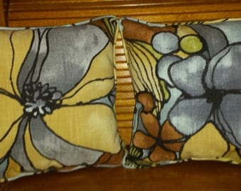 Floral throw pillows with piping