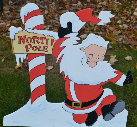 Happy Santa Clause at the North Pole lawn stake Christmas decoration