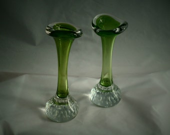 A matched pair of green crystal glass bone vases with controlled bubble base. Scandinavian art glass probably by Aseda.