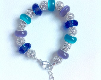 Bracelet charms in lampwork beads Murano, blue, black and silver
