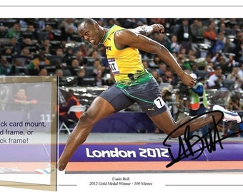 Usain Bolt London Olympics 2012 Athlete, 100 Metres Gold Medal , signed autographed A4 print on card mount, black / gold frame