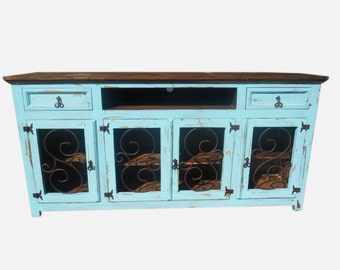 80 inch hi end turquoise tv stand with metal scroll on doors rustic design