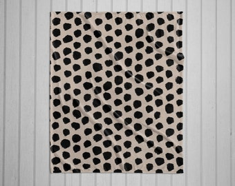 Black and tan dalmatian pattern modern plush throw blanket with white back