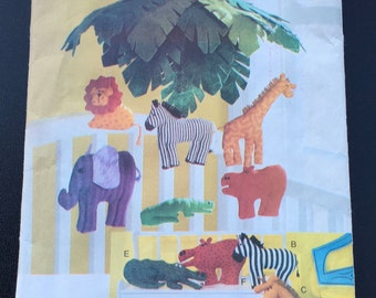 Vogue Craft 9160 517  Sewing Pattern Jungle Animal Pillows & Mobile Lion Giraffe Zebra Elephant Crocodile Alligator Hippo Hippopotamus UNCUT