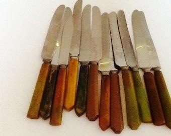 Assortment of vintage Bakelite flatware in green. Mid century vintage Bakelite utensils in brown green.