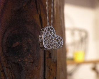 Silver necklace with heart pendant diamond drilled and