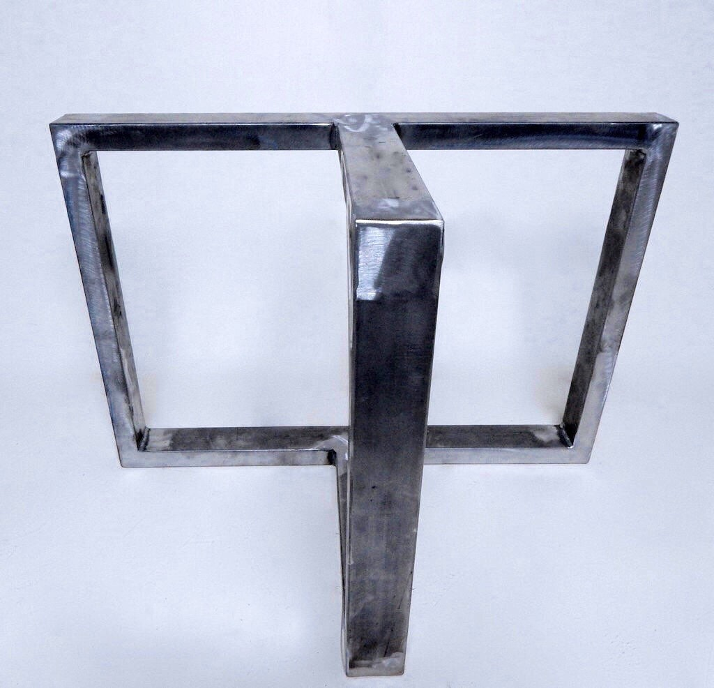 set of metal table legs shown in raw steel by