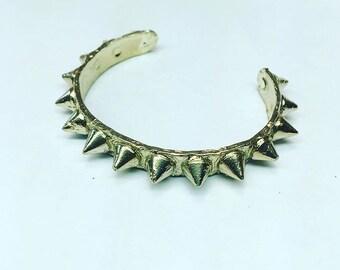 Brass spike cuff. Cast