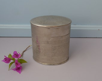 Vintage metal tin with carved decoration